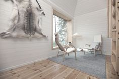 Tree hotel in Lapland by Sandell Sandberg architects: light grey Björk wool rug with leather edging by Lena Bergström for Design House Stockholm. Lamino Armchairs by Yngve Ekström for Swedese. Photography by Peter Lundström.