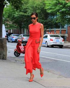 Victoria Beckham wearing a bright coral outfit she designed in June Moda Victoria Beckham, Style Victoria Beckham, Victoria Beckham Outfits, Fashion Mode, Look Fashion, Fashion Outfits, Womens Fashion, Fashion Photo, Street Fashion
