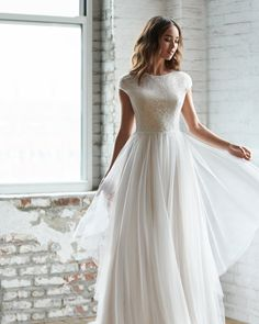 Style 7854 Riva Ti Adora by Allison Webb bridal gown - Ivory / Cashmere lace and English net A-line bridal gown. Lace illusion bodice with cap sleeves, eyelash trim at waist, and scalloped keyhole back. Wedding Dress Shopping, Modest Wedding Dresses, Wedding Bride, Wedding Gowns, Tulle Wedding, Garden Wedding, Boho Wedding, Dream Wedding, A Line Bridal Gowns