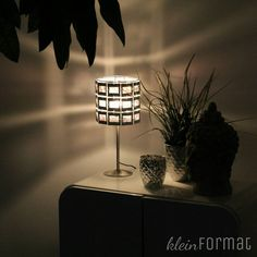 Diarahmenlampe in Aktion mit mega Wandschatten # Wohnzimmer #kommode #Dekoration #leuchte