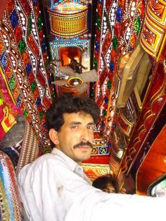 Islamabad, Pakistan ( The Inside of truck) look at the little ceiling fan!!!