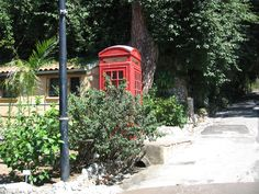 British phone booth with the botanical Garden of Gibraltar