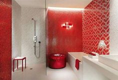 Red bathroom. Nice to have different walls with varying textures, but the same color ... http://www.bathroom-paint.net/bathroom-paint-color.php