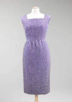 Ensemble  House of Givenchy  (French, founded 1952)    Designer:      Hubert de Givenchy (French, born Beauvais, 1927)  Designer:      Textile by Ascher (British)  Date:      1958  Culture:      French  Medium:      wool  Dimensions:      Length at CB (a): 40 in. (101.6 cm) Length at CB (b): 18 1/2 in. (47 cm)  Credit Line:      Brooklyn Museum Costume Collection at The Metropolitan Museum of Art, Gift of the Brooklyn Museum, 2009; Gift of Mrs. William Randolph Hearst, Jr., 1960  Accession…