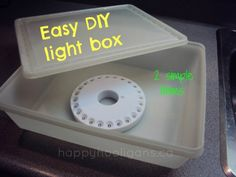 Make a small light box from an LED camping light and a plastic storage bin with transucent lid.  If this gets warm, drill little holes around sides of box.  From HappyHooligans.ca