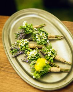 The guys sported boutonnieres of lavender, wax flower, blueberries, and rosemary at this laid-back Martha's Vineyard wedding.