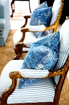 I have dining room chairs that look like these - even blue fabric - maybe a very soft pillow in each chair with ruffles all around would be the ticket..hmm, off to see what's in my sewing stash!
