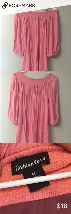 Peach 3/4 Length Sleeve loose Fit Top On or off the shoulder peach tunic.  Has a unique hem line as seen in the last picture.  No tags but never worn. Tops Tunics