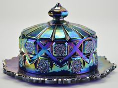 Dinnerware with an iridescent patina is called carnival glass and can be highly collectible. | 26 Common Thrift Store Finds You Can Flip To Make Money