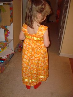 back of sundress has chest band that buttons - 4/9/12