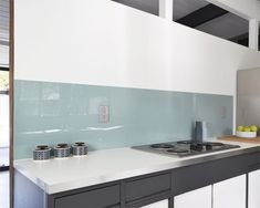 Instead of heavy glass, the homeowners installed lightweight painted acrylic as the backsplash. Not Your Basic Backsplash: A Lovely, Low-Maintenance Alternative to Tile Glass Backsplash Kitchen, Glass Tile Backsplash, Herringbone Backsplash, Glass Kitchen, Kitchen Backsplash, Backsplash Ideas, Glass Tiles, Grey Backsplash, Beadboard Backsplash