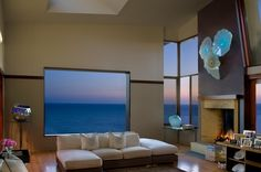 Rather than going for full-height-all-glass window walls, this smaller window makes the ocean look like framed artwork (by Tracy Murdock Allied ASID)