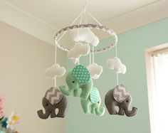 Welcome to FlossyTots This beautiful Elephant mobile is MADE TO ORDER The elephants come in pale mint green & grey, with grey chevron/polka dot fabric ears and a decorated hoop of grey chevron fabric. In the centre are three fluffy white clouds and one cloud above each elephant.