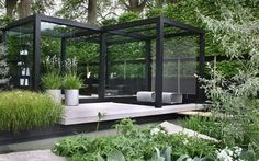 A modernized black pergola works well with the greenery. The light floors of the pergola create a a different level of living space within the garden. More The Daily Telegraph Garden by Ulf Nordfjell at Chelsea Flower Show 2009