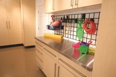 Racks help organize grab and go items from Tailored Living powered by Premier Garage