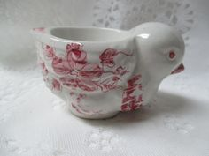 White egg cup with burgundy floral pattern. English .1950's