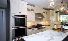 A modern look kitchen with a vintage lighting. Anyone would love to have this. #kitchen #lighting #countertop