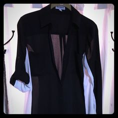 Original Fit Portofino Shirt, Black w White Sides An original... One of the OGs of the Portofino World! Used, but no stains or tears. Just trying to take the number of Portofinos from 100,000 in my closet down to 50,000. Cute for work or with skinny pants/faux leather pants and booties for drinks with the girls. Classy... Yet sexy! Express Tops Blouses