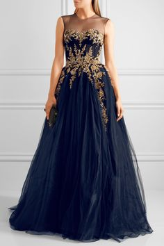 REEM ACRA ~ ~ Embellished tulle gown. Navy blue with gold embellishment. Cinched waist and well desogmed form-fitting above the skirt. Zipper in back. Illusion mesh left bare for the front and back yoke. Several layers of skirting. CAUTION: Trip alert! A fairly long tail in back.. ||| NET-A-PORTER. COM |||