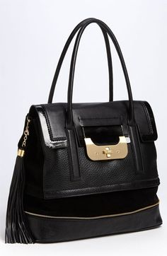 Add polish to your favorite uptown-girl looks with this chic carryall by DVF.  #DianeVonFurstenberg