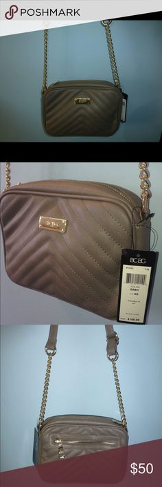 "BCBG Paris grey taupe shoulder/crossbody bag I'm selling a Grey taupe BCBG Paris shoulder bag. The front of it is quilted pattern. It is gold hardware. It has a gold zipper in the back. On the inside it has a zipper compartment and two pouches. It has a adjustable shoulder strap. The handle has gold chain on it. The bag measures 7"" X 10"" X 2"" (LxHxW) the handle is 24"" long. Beautiful bag. BCBG Bags Shoulder Bags"