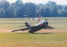 The tail strike occurred during at a 1990 airshow in Harrison, Arkansas. Photographer, who was a technician for the FAA and somewhat of a camera buff, was tracking with his camera, as this guy looped off the deck in a MiG-17. The pilot had just completed a loop and misjudged his pull-out. By the way, the guy just made a wide circle, lowered his landing gear, touched down . . then taxied in showing scratched paint, but no sheet metal damage. Photo via Thomas Harnish