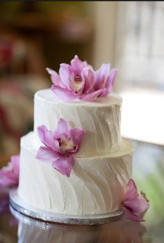 Simple white cake with orchids