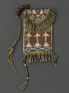 Possibly Ute  Woman's Belt Case, 1880-1890. Hide, metal, beads, pigment,