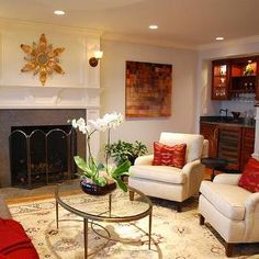 LORI PAINT SUGGESTION.  - Benjamin Moore Oystershell... living room, oval coffee table, glass top coffee table, oriental rug, gold sunburst mirror