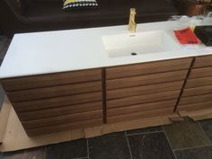 Multiform oak corian tapwell