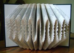 Folded book art, waves I, recycled book art by Dancing Grey Studio.