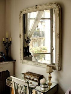 lovely white framed mirror with squared off corners on the bottom & rounded ones on the top / removed from a dresser perhaps