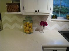 This is awesome how she did this for 8 bucks! DIY chevron backsplash. So cute totally doing this to my house!