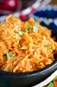 This Mexican Rice recipe is SO easy that you'll want to make it for all of your Mexican dishes! You can serve this Easy Mexican Rice (or Spanish Rice) as a side dish for all your Mexican meals! This simple Mexican Rice recipe doesn't include any extra fillings, so your picky kids will also love it!