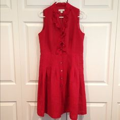 Red Sleeveless Dress Adorable sleeveless red dress. Size 14 petite, material is 76% rayon and 24% nylon lining is 100% polyester. In great condition and very comfortable. Buttons in the front going all the way down Coldwater Creek Dresses Midi
