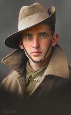 Studio portrait of an unidentified First World War soldier in Australian service uniform, including greatcoat and slouch hat.  (Source © AWM P06003.001)