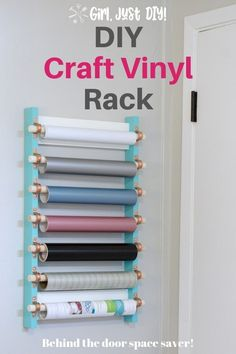 Need to keep your cricut and silhouette vinyl from getting damaged? Click over to see how to build your own space-saving craft vinyl storage rack like this one. #cricutvinylstorage #vinylstorageideas #silhouettevinylstorage #craftroomstorage #craftvinylstoragerack #girljustdiy
