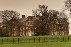 Raynham Hall, Norfolk England. Thought to be haunted by the ghost of Dorothy Townshend who lived in Raynham Hall in the 1700's. Legend has it that Dorothy was a mistress to Lord Wharton and her husband found out about it. She was imprisoned in a remote section of the Hall until she died. Legal records show she died in 1726.