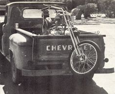 Two wheels riding on four.  Chopper motorcycle in the bed of a classic chevrolet truck. | Yellow 108