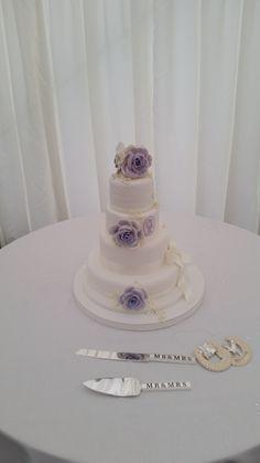 lilac and ivory wedding cake Ivory Wedding Cake, Wedding Cakes, Lilac, Desserts, Wedding Gown Cakes, Tailgate Desserts, Deserts, Cake Wedding, Syringa Vulgaris