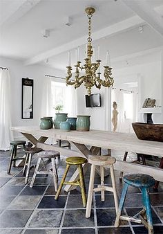 old stools + long rustic table + chunky chandelier and LOTS of light