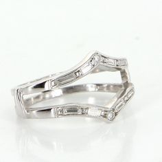 Overview: Elegant vintage wedding ring guard wrap, crafted in 14 karat white gold.  Single and straight baguette diamonds total an estimated 0.25