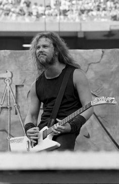 """Young JAMES HETFIELD of METALLICA, playing on stage his MORE BEER explorer guitar """"The World's No:1 Online Heavy Metal T-Shirt Store"""". Check it out our Metalhead Clothing and Apparel Store, Satanic Fashion and Black Metal T-Shirt Stores; www.HeavyMetalTshirts.net"""