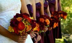 Lively plum burgundy and orange wedding, but I think it would be funner with different colored dresses.