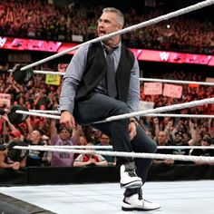 After he clears the ring, Shane invites Mr. McMahon to join him.