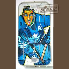 """In his """"Game Faces"""" series, Anthony Jenkins honoured Maple Leafs legend Tim Horton with two portraits. The co-founder of the famous coffee shop chain, won four Stanley Cups with the Leafs. Horton played for 24 seasons in a Hall of Fame career. Hockey Sweater, Tim Hortons, Game Face, Hockey Games, Sports Art, Little Books, Caricature, Nhl, Coffee Shop"""
