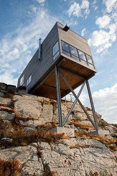 archatlas:  Cliff House MacKay-Lyons Sweetapple Architects This project is the first of a series of projects for a large 455 acre site on Nova Scotia's Atlantic coast. This pure box in the landscape is precariously perched off a bedrock cliff to heighten one's experience of the landscape through a sense of vertigo and a sense of floating on the sea. This strategy features the building's fifth elevation - its 'belly'.  null