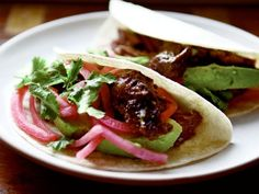 For those who are unaccustomed to cheek meat, braising it for tacos does wonders to accessibility because, after all, there's really nothing all that scary about a taco (right?). But odd cuts aside, these beef cheek tacos are pretty incredible. They're marinated in a mole-esque blend of spices, chiles, coffee, and peanut butter with a deep yet mellow spiciness that permeates the cheeks beautifully.