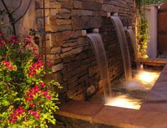 How soothing would it be to sit near this on a cool summer's eve and listen to water falling from a Flagstone Wall?!