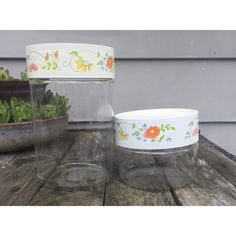 Pyrex Canister Set - White Wildflower / Flower - Vintage Retro Mid Century - Yellow Orange Blue Green Pink - Made in USA by shhhitsvintage on Etsy https://www.etsy.com/listing/294848419/pyrex-canister-set-white-wildflower